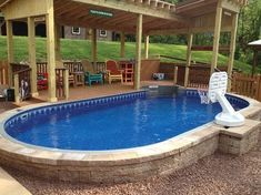Oval semi-inground pool surrounded by paver stones. OMG this may be it!! Time to start deck construction. Love this #deckconstruction