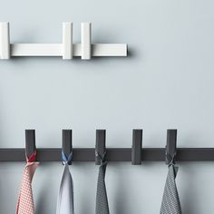 The traditional American Shaker coat rack with a shelf is reinterpreted here by , Product specs, Find dealer A Shelf, Shelves, Metal Bar, Magnetic Knife Strip, Coat Hooks, Modern Lighting, Modern Decor, Storage Spaces, Beams