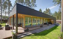 Prefab house / glue-laminated wood / contemporary / energy-efficient