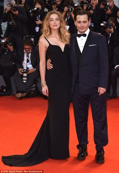 Suited and booted: Impeccably dressed in a midnight blue tuxedo, Johnny displayed his hand...