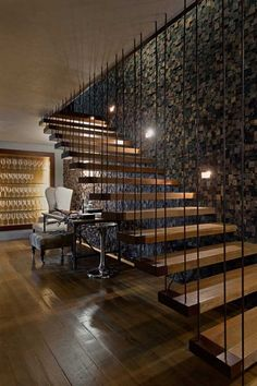 Floating stairs w/ subway tile wall