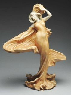 "Amphora Ceramic Loie Fuller Dancer Sculpture. 20"" T. Circa 1900. Amphora oval mark, Austria mark, Imperial Amphora mark"
