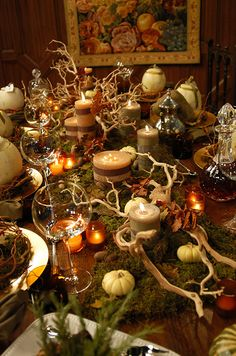Decorate a seasonal table with moss, tree branches, dried leaves and squash for a beautiful autumnal feel.