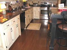 cream cabinets with black appliances   RE: Granite Tile Countertop In White Kitchen with Black Appliance