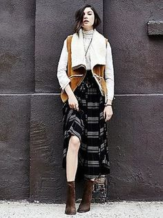 Layering is key when it comes to this plaid midi skirt. With a pair of lace-up booties and drapey top with an open vest or cardigan, this look is lush and cozy.