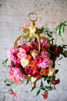 hanging flower display, photo by Greer Gattuso Photography http://ruffledblog.com/notwedding-new-orleans #weddingflowers #pink