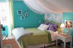 tule with string lights as a headboard.