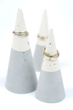 cement in cones? and then acrylic... for display and ring holders?