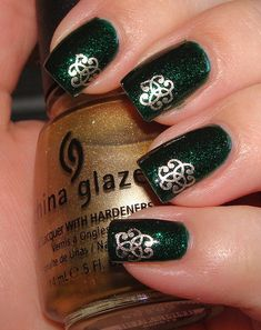 China Glaze Emerald Sparkle base with a simple golden celtic knot stamped on with China Glaze Passion and Konad plate s06,