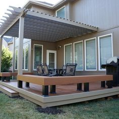 Low-level TimberTech deck with built-in benches and pergola.   Urban Designs and Developement   decks.com