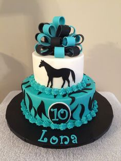2 tier zebra/horse themed cake with buttercream icing and fondant accents.