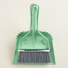 Our happy Mint Smiley Dustpan brings a housewarming quality to your chores. It features a broom that compactly attaches to the steel smiley faced dustpan, bringing a light and cute touch to the kitchen or bathroom.