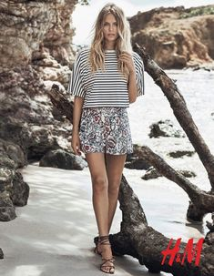The Russian model sports a striped shirt with floral print shorts