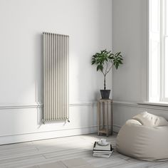 Terma Delfin Vertical Designer radiator Soft White Powder Paint mm mm - B&Q for all your home and garden supplies and advice on all the latest DIY trends Interior, Vertical Frames, Designer Radiator, Contemporary Decor, Tall Cabinet Storage, Powder Paint, Vertical, White, Wall Spaces