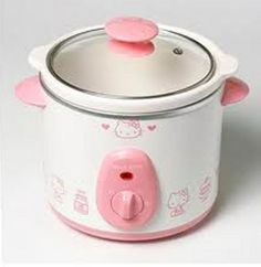 I don't think I'd feel very grown up cooking in a Hello Kitty croc pot... but it sure is cute.