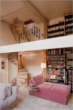 library with stairs leading to my art studio overlooking the forest. here's to wishful thinking...