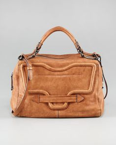 "$498.00 Kooba | Grove Leather Satchel Bag - CUSP. Choose black or tan leather. Gunmetal hardware. Double top handles. Adjustable crossbody strap with shoulder pad. Zip top. Large front flap pocket and back zip pocket. Sides pinch together with linked chain detail. Interior, one zip pocket and two open pockets; fabric lining. 8""H x 12""W x 7""D. Imported."