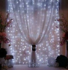 White christmas lights and sheer curtains - beautiful - doing this in my bedroom.