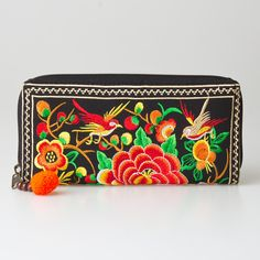 Changnoi Orange Bird Woman's Wallet Hmong Embroidered with Zipper with Pom Pom. The beautiful bag is made with an amazing piece of fabric woven by the HMONG hill tribes of Lanna Country (Northern Thailand). It feature this wallet with cute pom pom pull zipper. Inside there is one zippered pocket and 8 card slots. N.B. YOU MAY NOT RECEIVE THE EXACT BAG PICTURED HERE, AS THE FABRIC DESIGN MAY VARY SLIGHTLY FROM BAG TO BAG. THE EMBROIDERED CLOTH IS NEVER DUPLICATED. THIS MAKES EACH BAG…