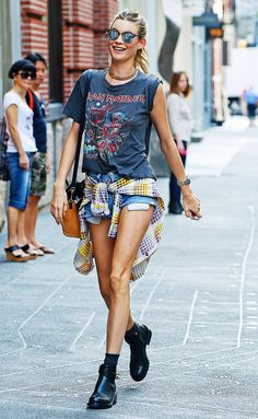 Behati Prinsloo wearing a vintage graphic tee, cutoff short, and black ankle boots