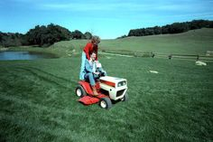 President Ronald Reagan and Nancy Reagan riding on their new lawn mower, an anniversary present, at Rancho Del Cielo. 3/4/82.