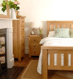 Portland Oak, bed, tall boy, bedside cabinet, bedside table, fireplace, wooden floors, flowers, mirror, country bedroom, country style
