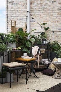 Inspiring balcony with great furnitures, storage, textiles and decoration details.