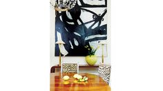 Leopard Louis Chairs + Abstract Art + Mid Century console by Nola interior designer Melissa Miles Rufty via Domaine