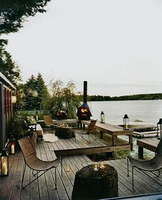 I like the multiple seating areas on this waterfront deck.
