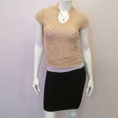 "Cache gold shimmery knit top Worn once, in excellent condition. Tan shimmery gold. 67 % silk, 21% cotton, 11% polyester, 1 % other fabrics. 24"" inches long! not counting the collar. Doesn't come with Cami shown in pictures! Cache Tops"