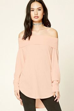 A ribbed knit top featuring an off-the-shoulder design, long raglan sleeves, and a dolphin hem.