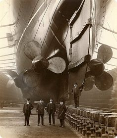 """Wentworth Jr. scoffed, """"But we must race to achieve the prizes of our age."""" """"At what price?"""" asked Reverend Robbins. """"This desire for speed is said to have sealed on of the workers on this very ship within her bowels, entombed alive in the depths below us. . . ."""""""