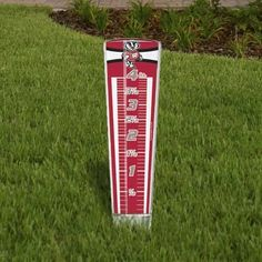"Wisconsin Badgers Rain Gauge ** by WinCraft. $14.95. Officially licensed rain gauge. Designed to magnify the numbers by more than 35% when water is caught. Made of durable plastic with full color back. Plastic stake in the bottom to stick into the ground and pre drilled holes for hanging. Measures approximately 13"" high and 3"" wide."