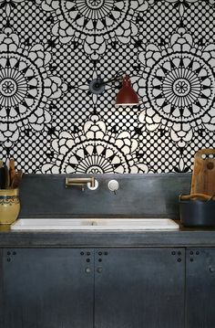 Oriental tiles and blue steel kitchen cabinets