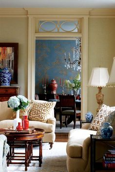 Greek key fabric on pillow-Cindy Rinfret...blue Gracie wallpaper in dining room