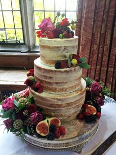 Our current favourite nearly naked cake...with fresh flowers, fresh fruit and yummy figs...