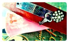 "Leather cuff. Stamped metal ""Fight Like a Girl."" Antique key and rhinestone flower."
