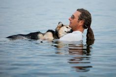 When John Unger had suicidal thoughts after a breakup, it was his dog Shoep who brought him back from the brink. This photograph shows Unger cradling his friend in lake Superior to soothe the dog's arthritis.