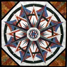 Made by Sandy Leuth. Mariners Compass pattern by Judy Niemeyer.