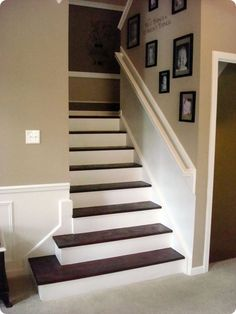 DIY boxed trim on stairs wall made  out of mdf board cut into strips. Low cost option for trim.