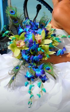 BLUE & GREEN ORCHIDS WITH PEACOCK FEATHER TFM-WB412