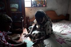 A home health care worker provides a woman with her HIV medication. In many parts of Tanzania, women living with HIV face barriers to accessing contraception.