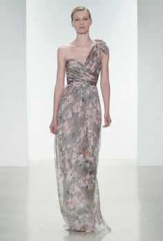 A one-shouldered, printed chiffon @amsalemaids bridesmaid dress with a bow neckline | Brides.com