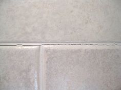 Three years ago, I had one of my bathrooms completely gutted and remodeled. I am having problems with some of the grout around the tiles on the shower walls cra…