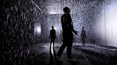 "Cool... A clever new installation at Barbican's Curve Gallery in London is getting showered with praise. Devised by UK-based rAndom International, the ""Rain Room"" allows visitors to pass through a downpour without getting wet. The installation is set on a darkened stage solely lit by one large spotlight. Cameras map human movement in the 100-square-meter room and send instructions for the rain to move near people, yet not too near, as they traverse the space."