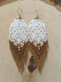A starry night piece inspired by the abundant fall harvest in California wine country. Rich golds, russet, and Cabernet colors warm these eye catching fringe earrings. Please note that these earrings are made to order. Not one pair of starry night earrings are alike another. One of the