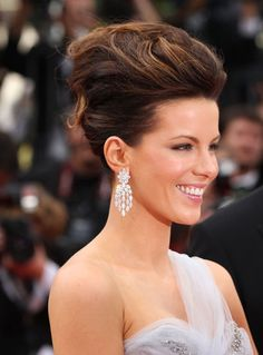 Kate Beckinsale is pretty much our collective number one updo crush on this site. But could this incredibly voluminous 'do she wore to the Robin Hood premiere at the Cannes Film Festival last night her first mistake in the hair department? Big Hair Updo, One Hair, Teased Hair, Updo Hairstyle, Trendy Hairstyles, Wedding Hairstyles, Modern Haircuts, Kate Beckinsale Hair, High Updo