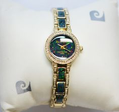 Ladies Opal face watch set with 6 rectangular mosaic opals in the band