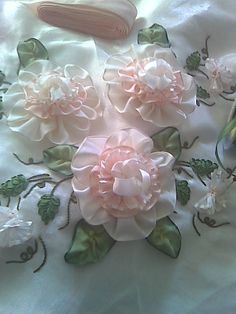 ribbon flowers. - light and airy compared to the usual, nice for shabby chic