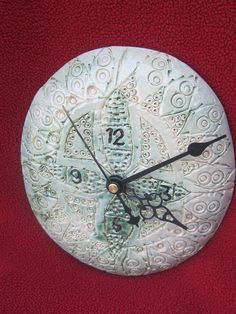 A ceramic clock for your wall.. $22.00, via Etsy.